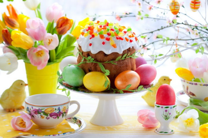Easter cake and colourful eggs on festive Easter table
